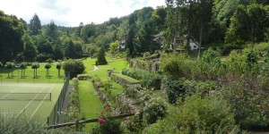Gidleigh Park lawns and gardens lead to a well-set up Tudorbethan style manor house.