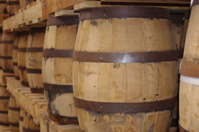There is an awful lot of whisky in barrel at the distillery. The-barrels-are-now-kept-standing-up-as they are easier to move around than when lying in cradles
